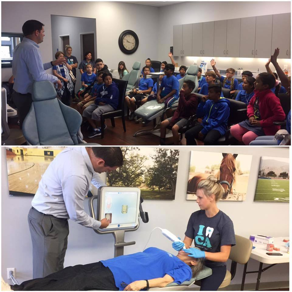 Dr. Ryan Hodges teaching a visiting class of children in his dental office